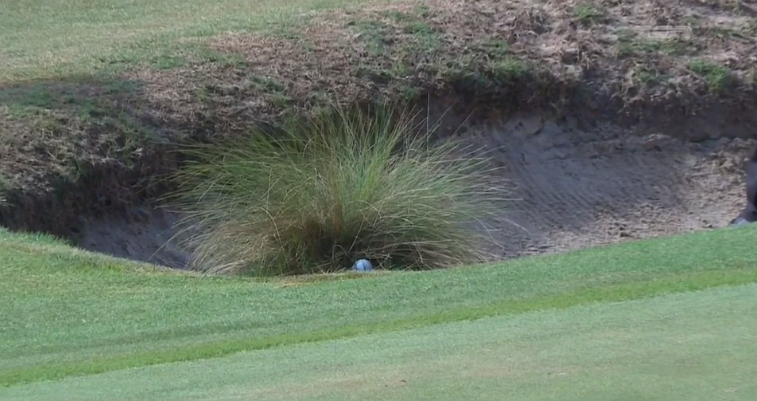 Ken Duke had to putt into a bunker from here.