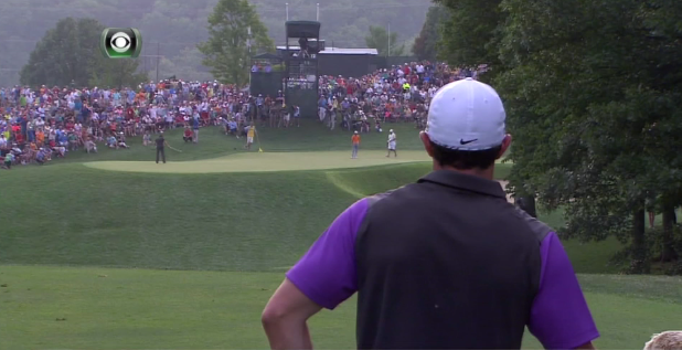 Rory watches the Mickelson/Fowler group from the tee.