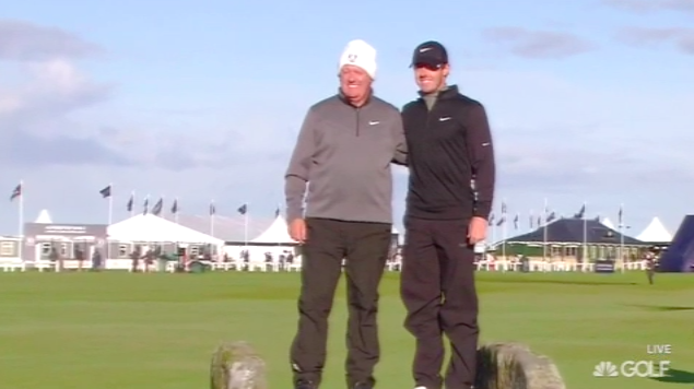 Rory McIlroy and father Gerry posing for a photo on the Swilcan Bridge.