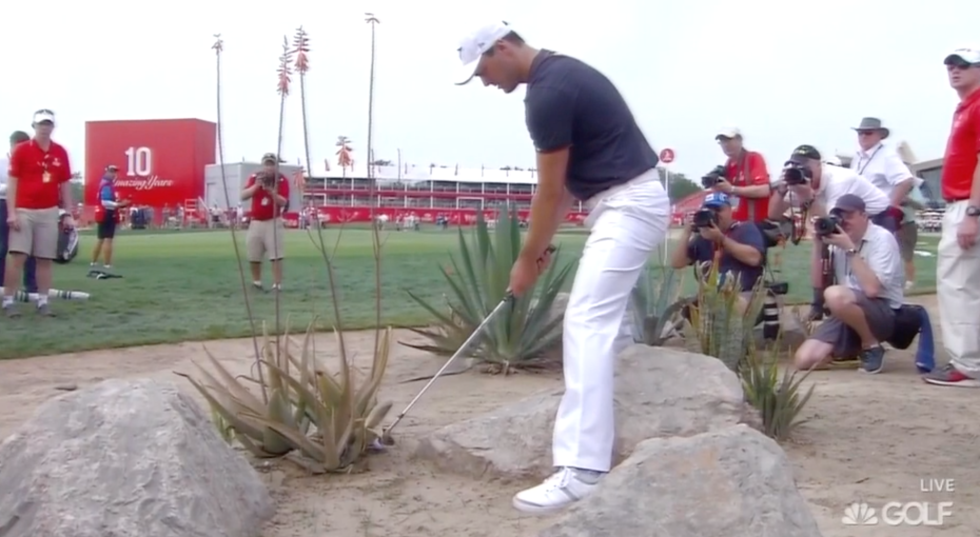 Kaymer with the rocks and shrubs. Not sure I'd be standing there if I was a photographer.